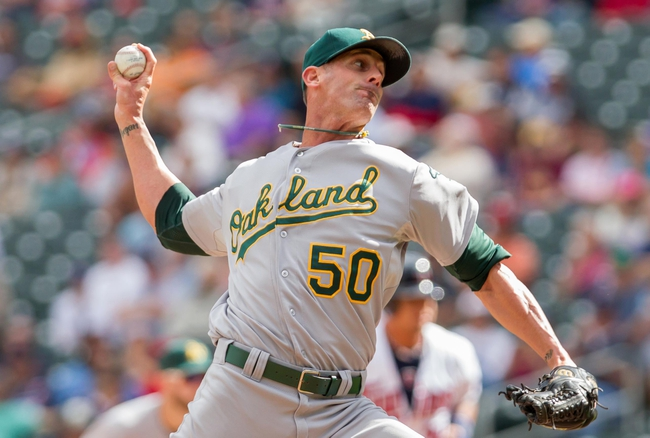 Sep 12, 2013; Minneapolis, MN, USA; Oakland Athletics pitcher Grant Balfour (50) throws a pitch in the ninth inning against the Minnesota Twins at Target Field. Mandatory Credit: Brad Rempel-USA TODAY Sports