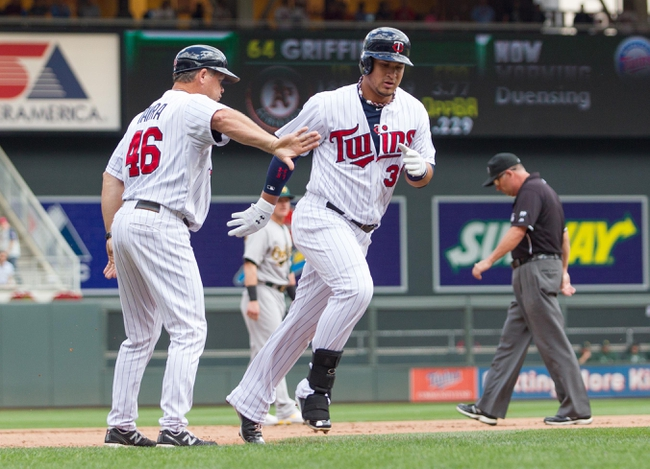 Sep 12, 2013; Minneapolis, MN, USA; Minnesota Twins outfielder Oswaldo Arcia (31) rounds third base after his home run in the eighth inning against the Oakland Athletics at Target Field. Mandatory Credit: Brad Rempel-USA TODAY Sports