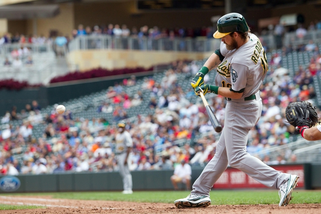 Sep 12, 2013; Minneapolis, MN, USA; Oakland Athletics right fielder Josh Reddick (16) hits a home run in the eighth inning against the Minnesota Twins at Target Field. Mandatory Credit: Brad Rempel-USA TODAY Sports