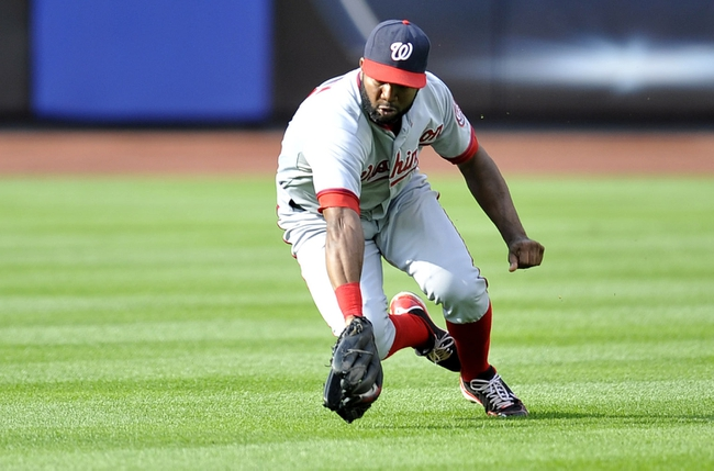 Sep 12, 2013; New York, NY, USA; Washington Nationals center fielder Denard Span (2) makes a sliding catch on a fly ball during the seventh inning against the New York Mets at Citi Field. Mandatory Credit: Joe Camporeale-USA TODAY Sports