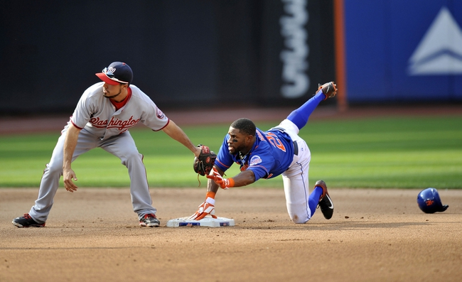 Sep 12, 2013; New York, NY, USA; New York Mets left fielder Eric Young Jr. (22) slides in safely at second base to beat a throw to Washington Nationals second baseman Anthony Rendon (6) for a stolen base during the seventh inning at Citi Field. Mandatory Credit: Joe Camporeale-USA TODAY Sports