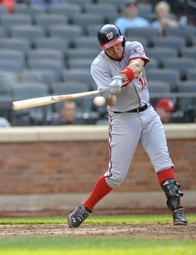 Sep 12, 2013; New York, NY, USA; Washington Nationals third baseman Ryan Zimmerman (11) hits an RBI double during the eighth inning against the New York Mets at Citi Field. Mandatory Credit: Joe Camporeale-USA TODAY Sports