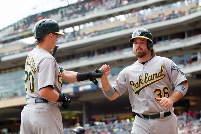Sep 12, 2013; Minneapolis, MN, USA; Oakland Athletics catcher Derek Norris (36) gets congratulated by third baseman Josh Donaldson (20) in the third inning against the Minnesota Twins at Target Field. Mandatory Credit: Brad Rempel-USA TODAY Sports