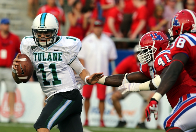 Sep 12, 2013; Ruston, LA, USA; Tulane Green Wave quarterback Nick Montana (11) is pressured by Louisiana Tech Bulldogs defensive linemen IK Enemkpali (41) and Vontarrius Dora (98) in the first quarter at Joe Aillet Stadium. Mandatory Credit: Chuck Cook-USA TODAY Sports