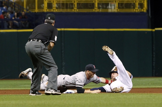 Sep 12, 2013; St. Petersburg, FL, USA; Boston Red Sox shortstop Stephen Drew (7) tags out Tampa Bay Rays right fielder Matt Joyce (20) as he attempted to steal second base during the fourth inning at Tropicana Field. Mandatory Credit: Kim Klement-USA TODAY Sports