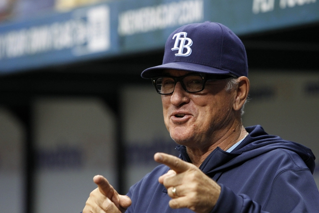 Sep 12, 2013; St. Petersburg, FL, USA; Tampa Bay Rays manager Joe Maddon (70) smiles and points during the fourth inning against the Boston Red Sox at Tropicana Field. Mandatory Credit: Kim Klement-USA TODAY Sports
