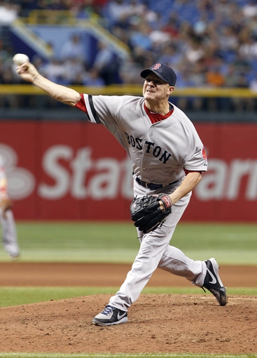 Sep 12, 2013; St. Petersburg, FL, USA; Boston Red Sox starting pitcher Jake Peavy (44) throws a pitch during the fourth inning against the Tampa Bay Rays at Tropicana Field. Mandatory Credit: Kim Klement-USA TODAY Sports