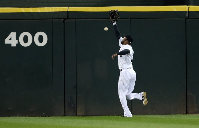Sep 12, 2013; Chicago, IL, USA; Chicago White Sox center fielder Alejandro De Aza is unable to catch a ball hit for a double by Cleveland Indians catcher Yan Gomes (not pictured) during the first inning at U.S Cellular Field. Mandatory Credit: Jerry Lai-USA TODAY Sports