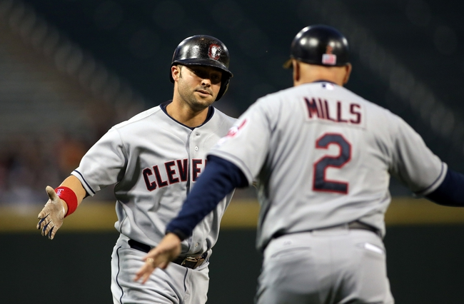Sep 12, 2013; Chicago, IL, USA; Cleveland Indians first baseman Nick Swisher (left) is congratulated by third base coach Brad Mills (2) after hitting a solo home run against the Chicago White Sox during the first inning at U.S Cellular Field. Mandatory Credit: Jerry Lai-USA TODAY Sports