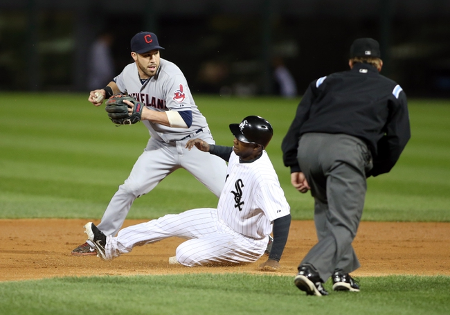 Sep 12, 2013; Chicago, IL, USA; Cleveland Indians second baseman Jason Kipnis (left) turns a double play over Chicago White Sox center fielder Alejandro De Aza (middle) during the first inning at U.S Cellular Field. Mandatory Credit: Jerry Lai-USA TODAY Sports