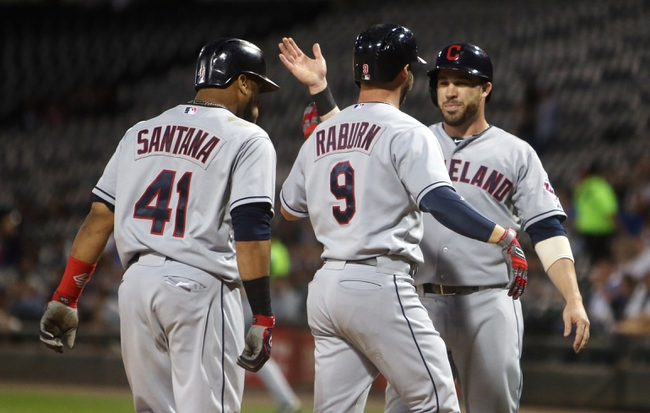 Sep 12, 2013; Chicago, IL, USA; Cleveland Indians right fielder Ryan Raburn (9) is congratulated by teammates Carlos Santana (41) and Jason Kipnis (right) after hitting a three-run home run against the Chicago White Sox during the first inning at U.S Cellular Field. Mandatory Credit: Jerry Lai-USA TODAY Sports