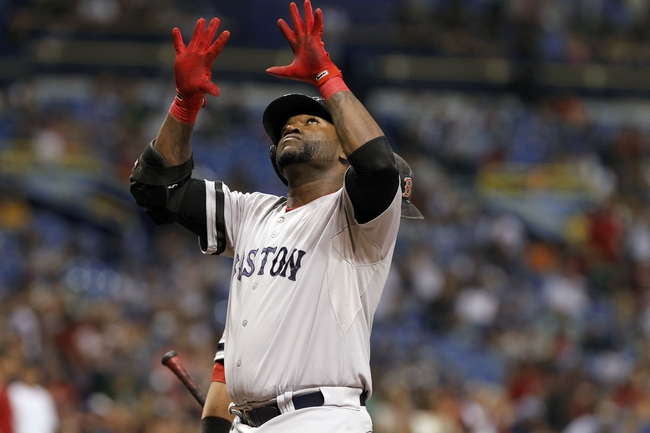 Sep 12, 2013; St. Petersburg, FL, USA; Boston Red Sox designated hitter David Ortiz (34) reacts at home plate after he hit a solo home run during the sixth inning against the Tampa Bay Rays at Tropicana Field. Mandatory Credit: Kim Klement-USA TODAY Sports