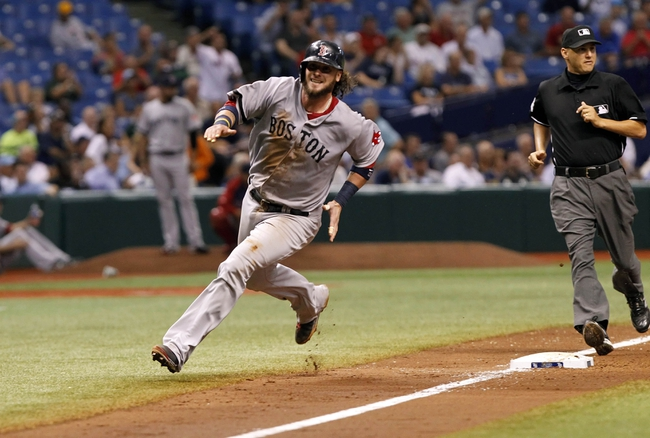 Sep 12, 2013; St. Petersburg, FL, USA; Boston Red Sox catcher Jarrod Saltalamacchia (39) runs around third base to score a run during the sixth inning against the Tampa Bay Rays at Tropicana Field. Mandatory Credit: Kim Klement-USA TODAY Sports