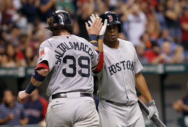 Sep 12, 2013; St. Petersburg, FL, USA; Boston Red Sox catcher Jarrod Saltalamacchia (39) is congratulated by shortstop Xander Bogaerts (72) after he scored a run during the sixth inning against the Tampa Bay Rays at Tropicana Field. Mandatory Credit: Kim Klement-USA TODAY Sports