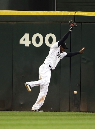 Sep 12, 2013; Chicago, IL, USA; Chicago White Sox center fielder Alejandro De Aza is unable to catch a ball hit for a double by Cleveland Indians catcher Yan Gomes (not pictured) during the third inning at U.S Cellular Field. Mandatory Credit: Jerry Lai-USA TODAY Sports