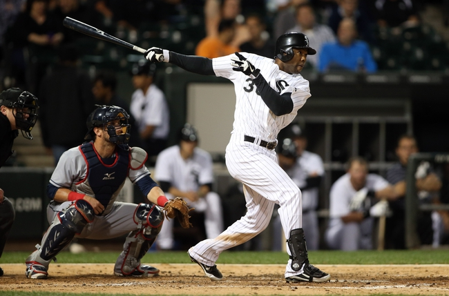 Sep 12, 2013; Chicago, IL, USA; Chicago White Sox center fielder Alejandro De Aza hits a RBI single against the Cleveland Indians during the third inning at U.S Cellular Field. Mandatory Credit: Jerry Lai-USA TODAY Sports