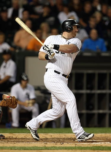 Sep 12, 2013; Chicago, IL, USA; Chicago White Sox designated hitter Adam Dunn hits a single against the Cleveland Indians during the third inning at U.S Cellular Field. Mandatory Credit: Jerry Lai-USA TODAY Sports