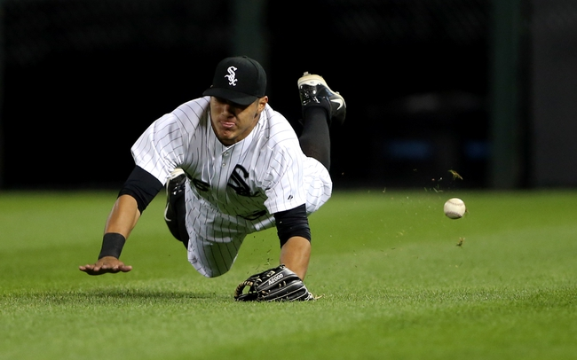 Sep 12, 2013; Chicago, IL, USA; Chicago White Sox right fielder Avisail Garcia is unable to catch a ball hit for a triple by Cleveland Indians center fielder Michael Bourn (not pictured) during the fourth inning at U.S Cellular Field. Mandatory Credit: Jerry Lai-USA TODAY Sports