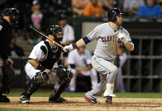 Sep 12, 2013; Chicago, IL, USA; Cleveland Indians second baseman Jason Kipnis drives in a run with a sacrifice fly during the fourth inning against the Chicago White Sox at U.S Cellular Field. Mandatory Credit: Jerry Lai-USA TODAY Sports