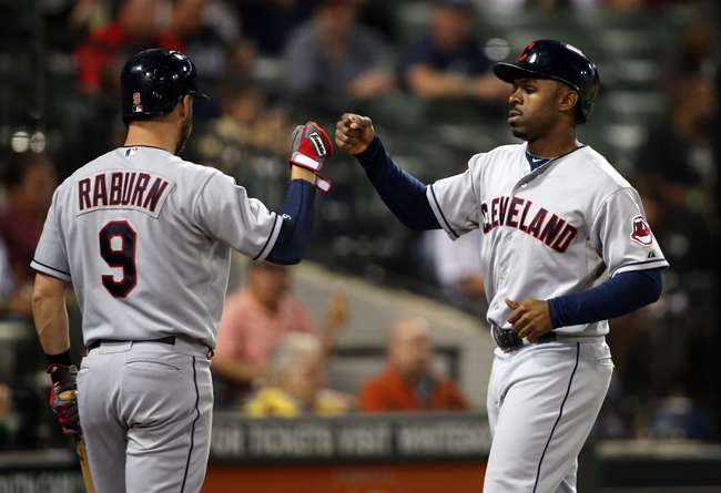 Sep 12, 2013; Chicago, IL, USA; Cleveland Indians center fielder Michael Bourn (right) is congratulated by right fielder Ryan Raburn (left) after scoring a run against the Chicago White Sox during the fourth inning at U.S Cellular Field. Mandatory Credit: Jerry Lai-USA TODAY Sports