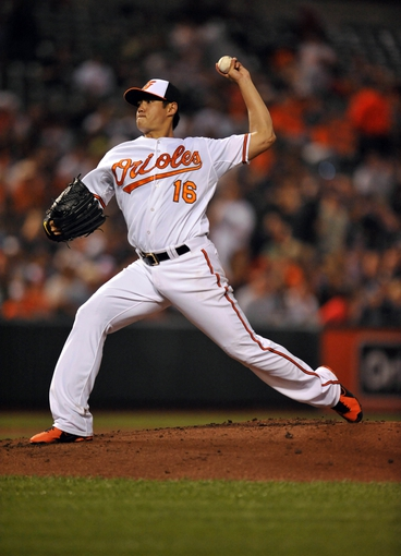 Sep 12, 2013; Baltimore, MD, USA; Baltimore Orioles starting pitcher Wei-Yin Chen (16) throws in the second inning against the New York Yankees at Oriole Park at Camden Yards. Mandatory Credit: Joy R. Absalon-USA TODAY Sports