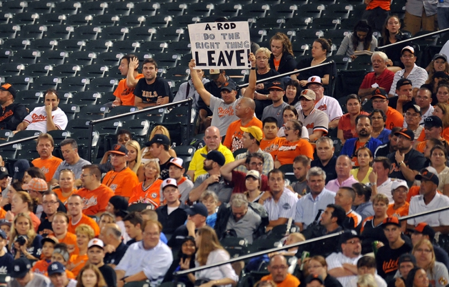 Sep 12, 2013; Baltimore, MD, USA; A Baltimore Orioles fan holds up a sign in protest of New York Yankees designated hitter Alex Rodriguez (not shown) during a game at Oriole Park at Camden Yards. Mandatory Credit: Joy R. Absalon-USA TODAY Sports