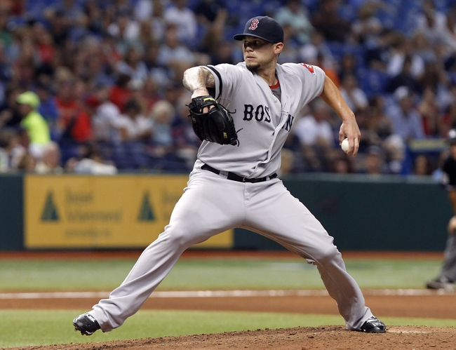 Sep 12, 2013; St. Petersburg, FL, USA; Boston Red Sox relief pitcher Drake Britton (66) throws a pitch during the seventh inning against the Tampa Bay Rays at Tropicana Field. Tampa Bay Rays defeated the Boston Red Sox 4-3. Mandatory Credit: Kim Klement-USA TODAY Sports
