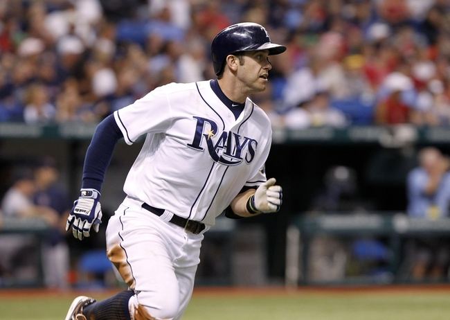 Sep 12, 2013; St. Petersburg, FL, USA; Tampa Bay Rays third baseman Evan Longoria (3) doubles during the eighth inning against the Boston Red Sox at Tropicana Field. Tampa Bay Rays defeated the Boston Red Sox 4-3. Mandatory Credit: Kim Klement-USA TODAY Sports