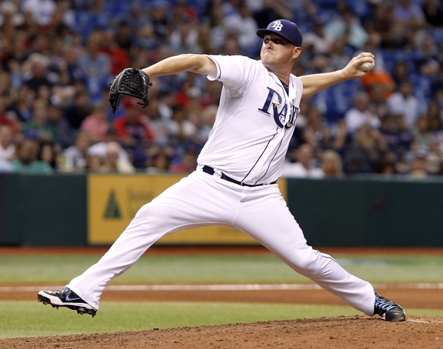 Sep 12, 2013; St. Petersburg, FL, USA; Tampa Bay Rays relief pitcher Jake McGee (57) throws a pitch during the eighth inning against the Boston Red Sox at Tropicana Field. Tampa Bay Rays defeated the Boston Red Sox 4-3. Mandatory Credit: Kim Klement-USA TODAY Sports