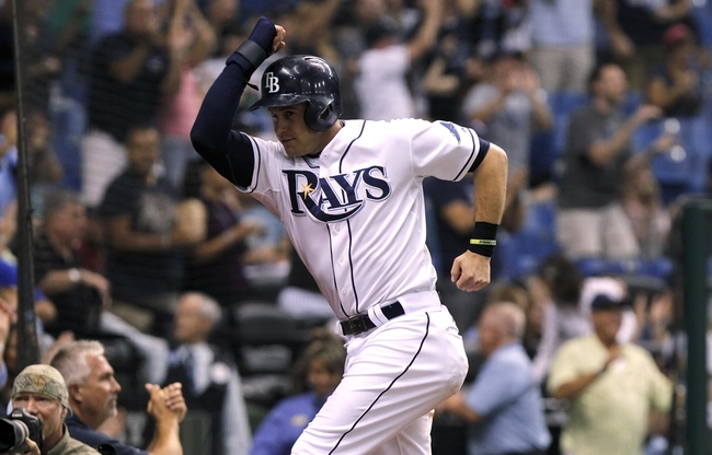Sep 12, 2013; St. Petersburg, FL, USA; Tampa Bay Rays third baseman Evan Longoria (3) reacts after he scored the winning run off right fielder Wil Myers (9) (not pictured) double during the eighth inning against the Boston Red Sox at Tropicana Field. Tampa Bay Rays defeated the Boston Red Sox 4-3. Mandatory Credit: Kim Klement-USA TODAY Sports