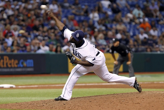 Sep 12, 2013; St. Petersburg, FL, USA; Tampa Bay Rays relief pitcher Fernando Rodney (56) throws a pitch during the ninth inning against the Boston Red Sox at Tropicana Field. Tampa Bay Rays defeated the Boston Red Sox 4-3. Mandatory Credit: Kim Klement-USA TODAY Sports