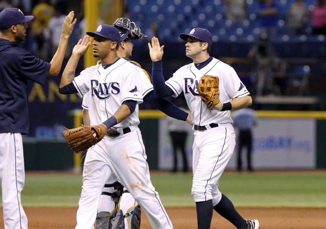 Sep 12, 2013; St. Petersburg, FL, USA; Tampa Bay Rays center fielder Desmond Jennings (8) and third baseman Evan Longoria (3) high five teammates after they beat the Boston Red Sox at Tropicana Field. Tampa Bay Rays defeated the Boston Red Sox 4-3. Mandatory Credit: Kim Klement-USA TODAY Sports
