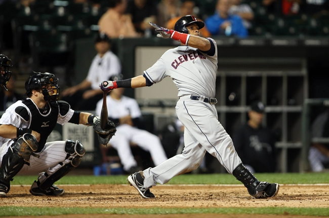 Sep 12, 2013; Chicago, IL, USA; Cleveland Indians designated hitter Carlos Santana hits a RBI single against the Chicago White Sox during the fifth inning at U.S Cellular Field. Mandatory Credit: Jerry Lai-USA TODAY Sports