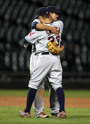 Sep 12, 2013; Chicago, IL, USA; Cleveland Indians first baseman Nick Swisher (33) celebrates with third baseman Lonnie Chisenhall after defeating the Chicago White Sox 14-3 at U.S Cellular Field. Mandatory Credit: Jerry Lai-USA TODAY Sports