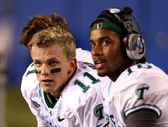 Sep 12, 2013; Ruston, LA, USA; Tulane Green Wave quarterback Nick Montana (11) talks to back-up quarterback Jordy Joseph (16) on the bench in the second quarter during their game against the Louisiana Tech Bulldogs at Joe Aillet Stadium. Mandatory Credit: Chuck Cook-USA TODAY Sports