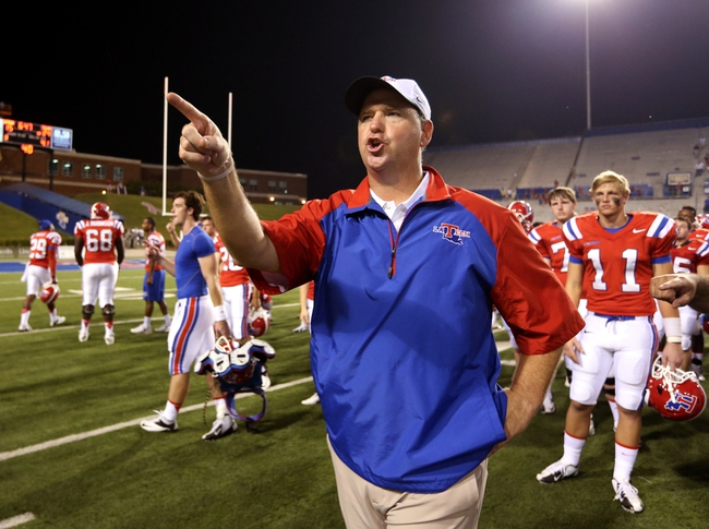 Sep 12, 2013; Ruston, LA, USA; Louisiana Tech Bulldogs head coach Skip Holtz thanks the band for playing the school alma mater at the end of their game against the Tulane Green Wave at Joe Aillet Stadium. Tulane won, 24-15. Mandatory Credit: Chuck Cook-USA TODAY Sports