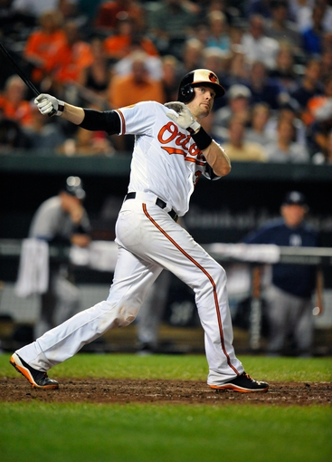 Sep 10, 2013; Baltimore, MD, USA; Baltimore Orioles catcher Matt Wieters (32) bats in the eighth inning against the New York Yankees at Oriole Park at Camden Yards. The Yankees defeated the Orioles 7-5. Mandatory Credit: Joy R. Absalon-USA TODAY Sports
