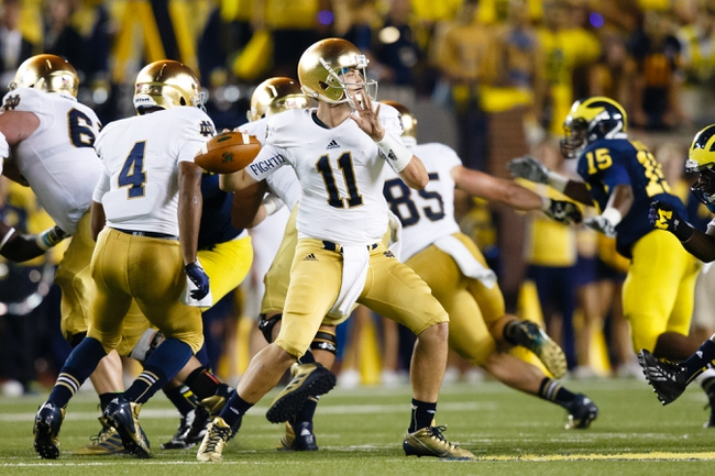 Sep 7, 2013; Ann Arbor, MI, USA; Notre Dame Fighting Irish quarterback Tommy Rees (11) passes the ball against the Michigan Wolverines at Michigan Stadium. Mandatory Credit: Rick Osentoski-USA TODAY Sports