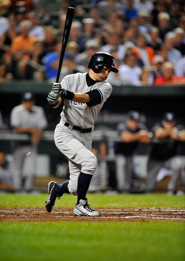 Sep 10, 2013; Baltimore, MD, USA; New York Yankees right fielder Ichiro Suzuki (31) bats in the second inning against the Baltimore Orioles at Oriole Park at Camden Yards. The Yankees defeated the Orioles 7-5. Mandatory Credit: Joy R. Absalon-USA TODAY Sports