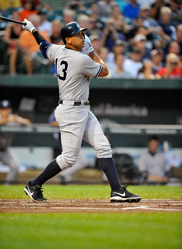 Sep 10, 2013; Baltimore, MD, USA; New York Yankees third baseman Alex Rodriguez (13) bats in the first inning against the Baltimore Orioles at Oriole Park at Camden Yards. The Yankees defeated the Orioles 7-5. Mandatory Credit: Joy R. Absalon-USA TODAY Sports