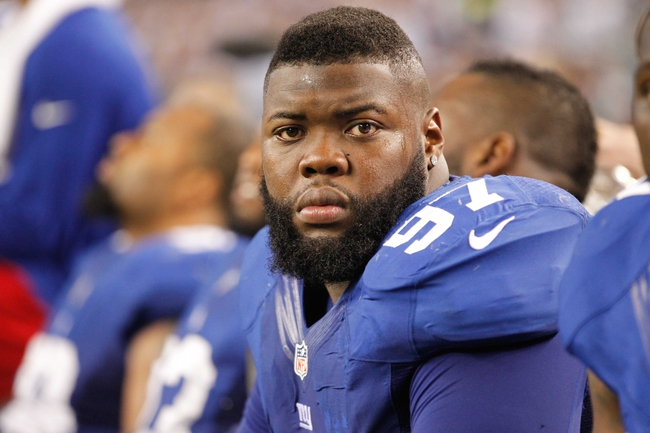 Sep 8, 2013; Arlington, TX, USA;  New York Giants defensive tackle Linval Joseph (97) on the sidelines during the game against the Dallas Cowboys at AT&T Stadium. The Dallas Cowboys beat the New York Giants 36-31. Mandatory Credit: Tim Heitman-USA TODAY Sports