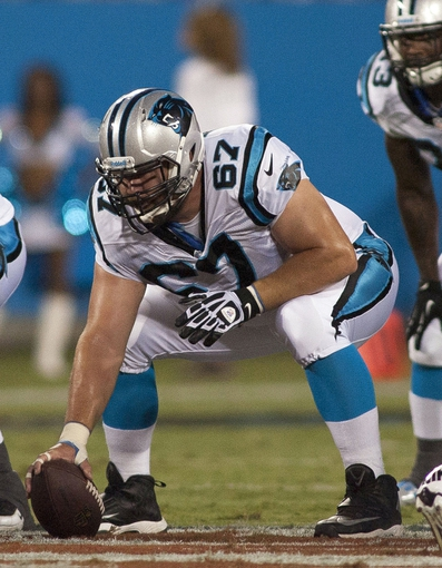 Aug 9, 2013; Charlotte, NC, USA; Carolina Panthers center Ryan Kalil (67) gets ready to snap the ball during the first quarter against the Chicago Bears. Mandatory Credit: Jeremy Brevard-USA TODAY Sports
