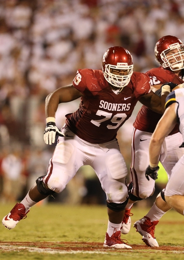 Sep 7, 2013; Norman, OK, USA; Oklahoma Sooners tackle Daryl Williams (79) in action against the West Virginia Mountaineers at Gaylord Family - Oklahoma Memorial Stadium. Mandatory Credit: Matthew Emmons-USA TODAY Sports