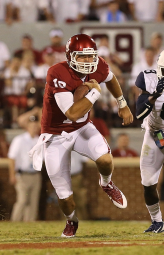 Sep 7, 2013; Norman, OK, USA; Oklahoma Sooners quarterback Blake Bell (10) runs with the ball against the West Virginia Mountaineers at Gaylord Family - Oklahoma Memorial Stadium. Mandatory Credit: Matthew Emmons-USA TODAY Sports