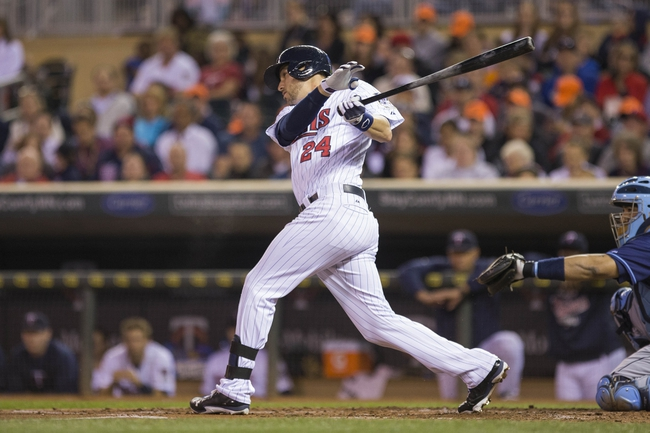 Sep 13, 2013; Minneapolis, MN, USA; Minnesota Twins third baseman Trevor Plouffe (24) hits a single in the second inning against the Tampa Bay Rays at Target Field. Mandatory Credit: Jesse Johnson-USA TODAY Sports