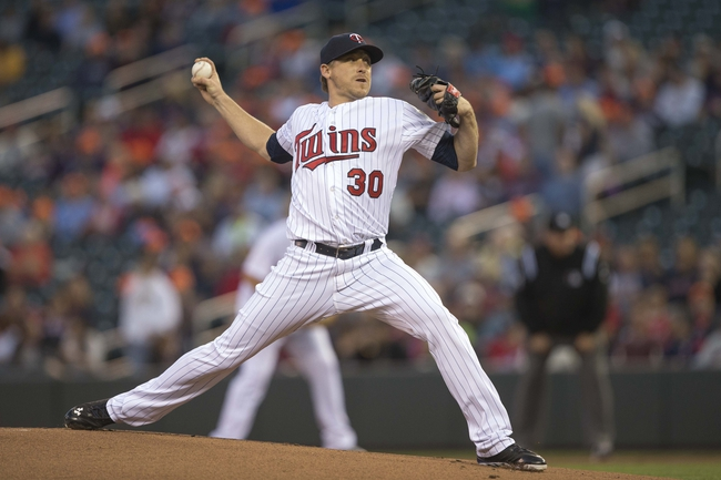 Sep 13, 2013; Minneapolis, MN, USA; Minnesota Twins starting pitcher Kevin Correia (30) delivers a pitch in the first inning against the Tampa Bay Rays at Target Field. Mandatory Credit: Jesse Johnson-USA TODAY Sports