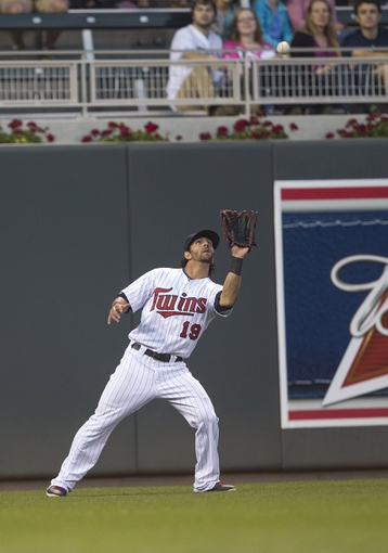 Sep 13, 2013; Minneapolis, MN, USA; Minnesota Twins right fielder Darin Mastroianni (19) catches a fly ball in the first inning against the Tampa Bay Rays at Target Field. Mandatory Credit: Jesse Johnson-USA TODAY Sports