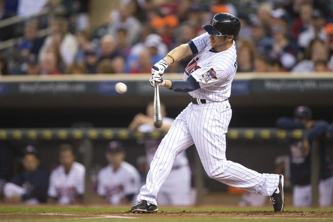 Sep 13, 2013; Minneapolis, MN, USA; Minnesota Twins left fielder Alex Presley (1) hits a single in the first inning against the Tampa Bay Rays at Target Field. Mandatory Credit: Jesse Johnson-USA TODAY Sports