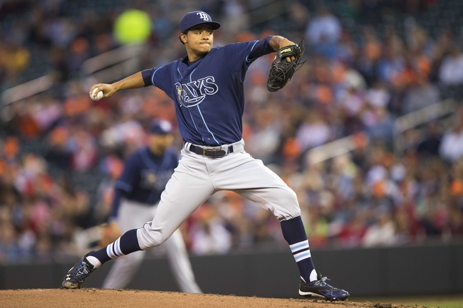 Sep 13, 2013; Minneapolis, MN, USA; Tampa Bay Rays starting pitcher Chris Archer (22) delivers a pitch in the first inning against the Minnesota Twins at Target Field. Mandatory Credit: Jesse Johnson-USA TODAY Sports