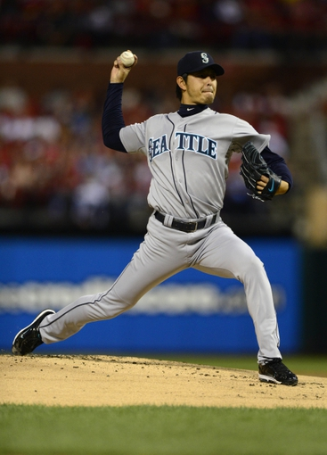 Sep 13, 2013; St. Louis, MO, USA; Seattle Mariners starting pitcher Hisashi Iwakuma (18) throws to a St. Louis Cardinals batter during the first inning at Busch Stadium. Mandatory Credit: Jeff Curry-USA TODAY Sports